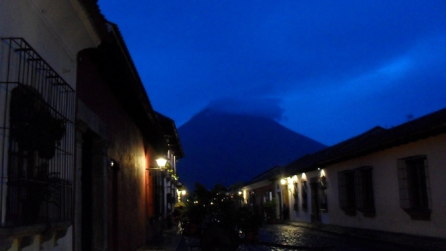 Antigua's streets during a rainy evening, Agua volcano in the background