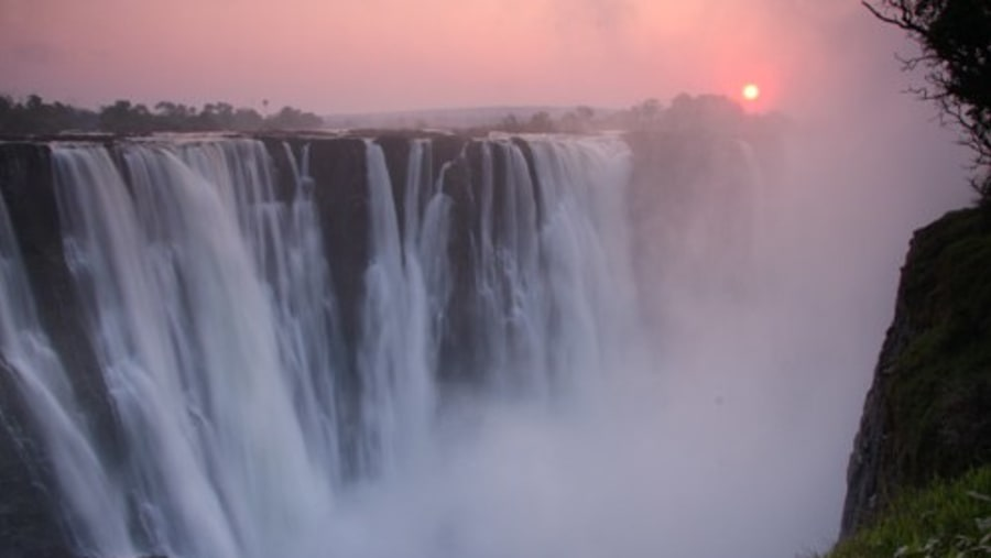 The Falls at sunrise, Zambia side as viewed from the Zimbabwe side