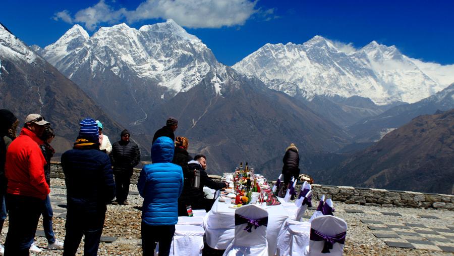 Having a champagne  breakfast at luxury resort in Kongde Everest