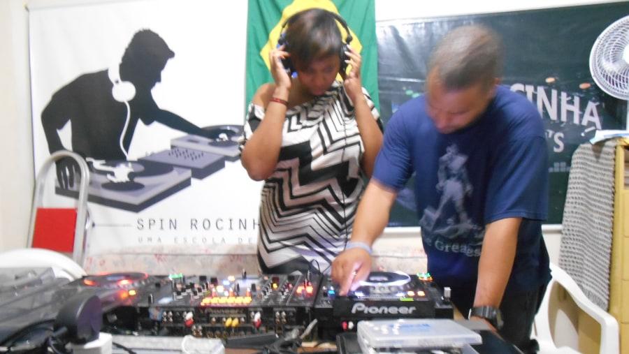 Tourists visit Spin Rocinha