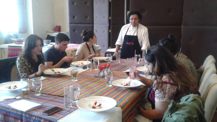 Participating in a cooking class at the Theatrum Restaurant.