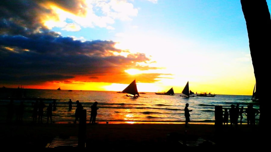 sunset front of white beach