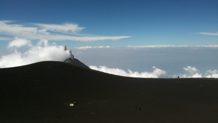 View of the summit crater rim, to the south in the background, Fuego volcano