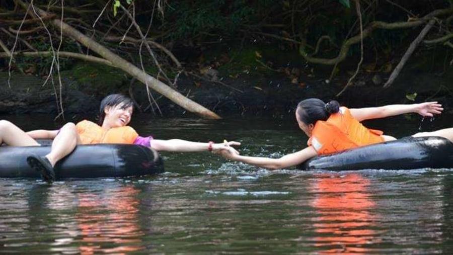 Tubing down river
