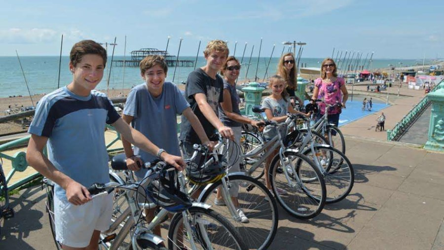 Family fun on a Brighton bike tour infront of the west pier
