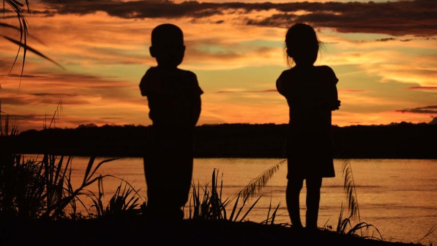 Beautiful Sunset and Beautiful Children from the peruvian Amazon