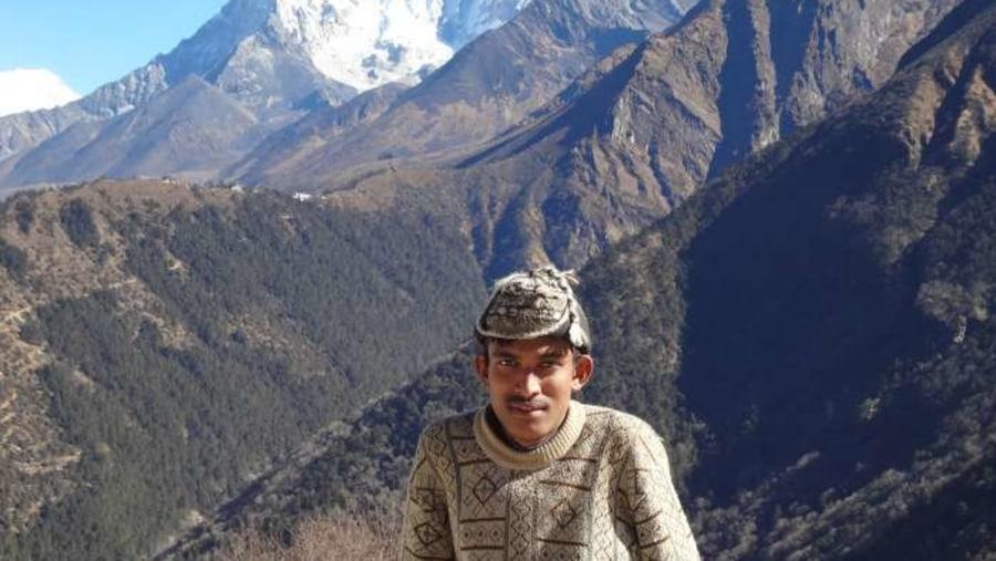 A trekking staff with Amadablum view.