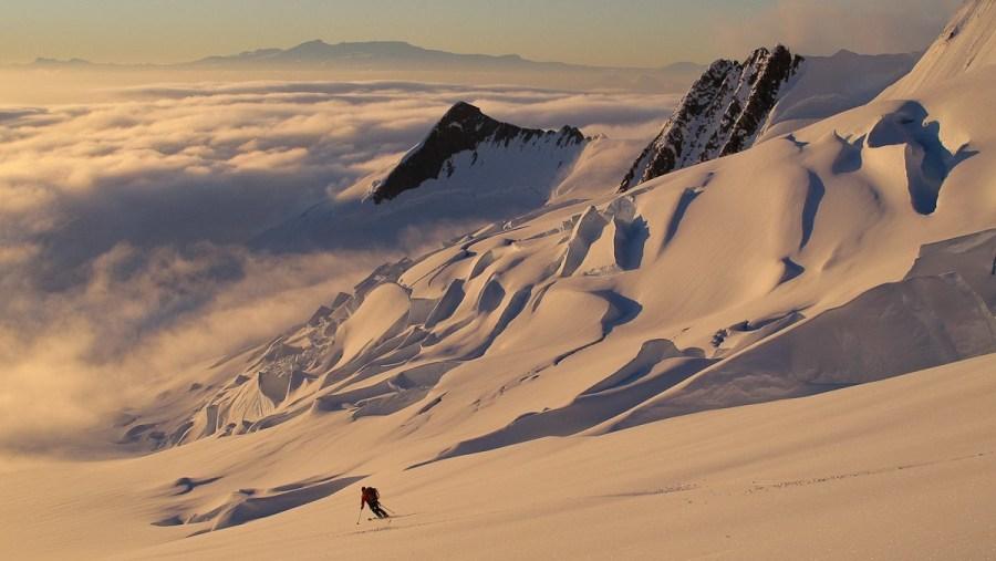 Antarctic sunset skiing above a cloud inversion