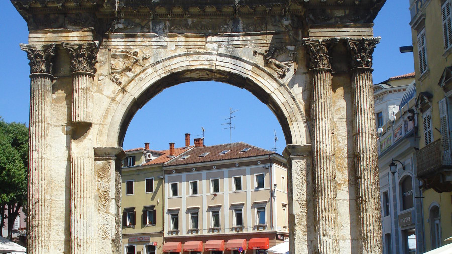 Triumphal Arch of the Sergi, also known as the Golden Gate, in Pula. Beautiful esoteric details carved into it.