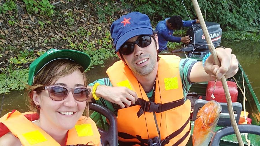 tourist catching their piranha