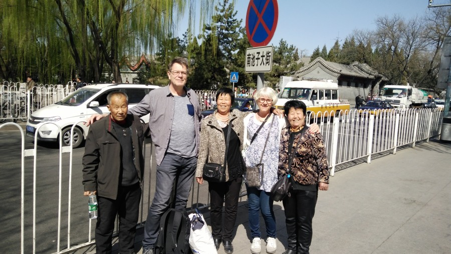 my family with the foreign guest on the street