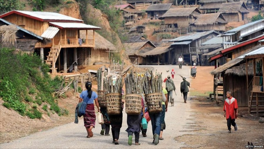 Hill tribes come back to home from working at their rice field in the northern Laos