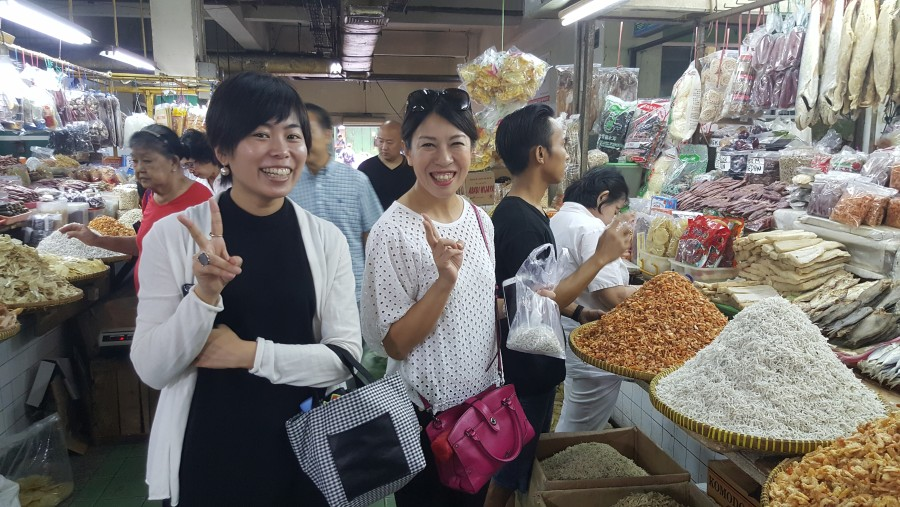 Traditional market with tourist from Japan