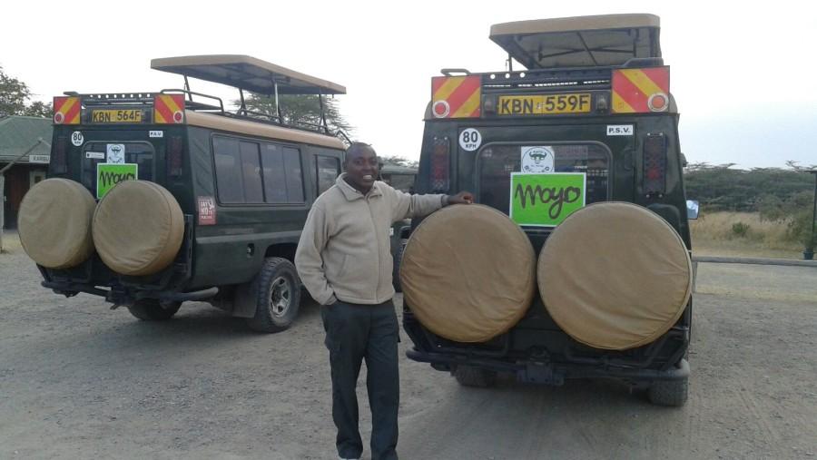 Beside a 4WD customised safari vehicle