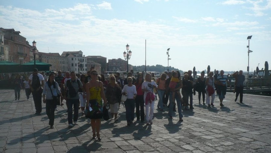 Venice, taking group towards Piazza Saint Marco to meet our local guide