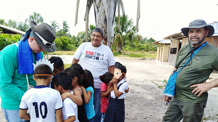 interacting with the local kids in the village
