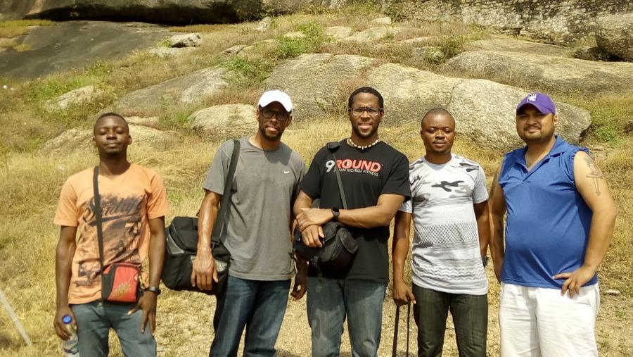 Ekele at olumo rock with twin doctors