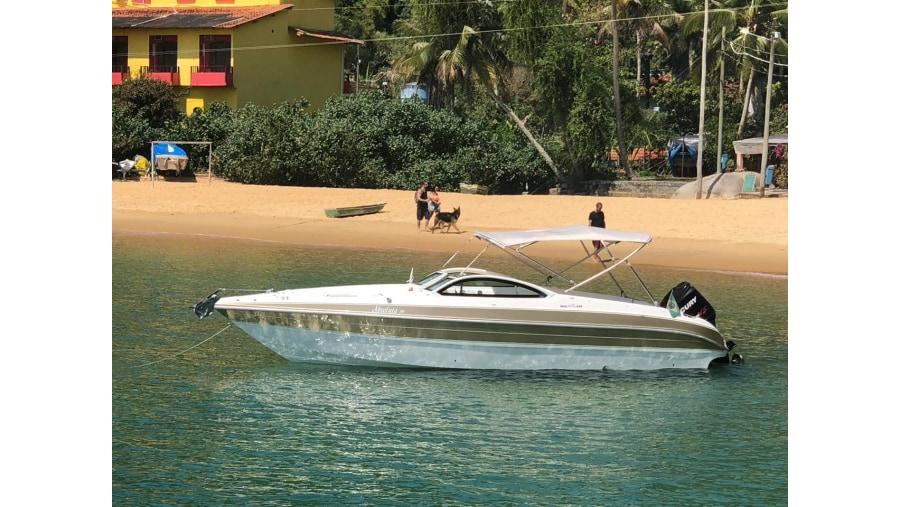 Motor boat at Portogalo beach