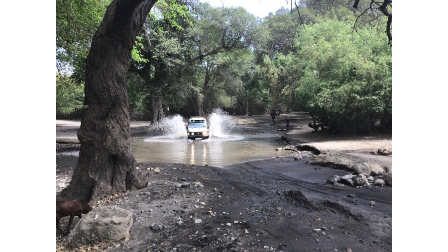 Driving along Ngarasero river in Lake Natron