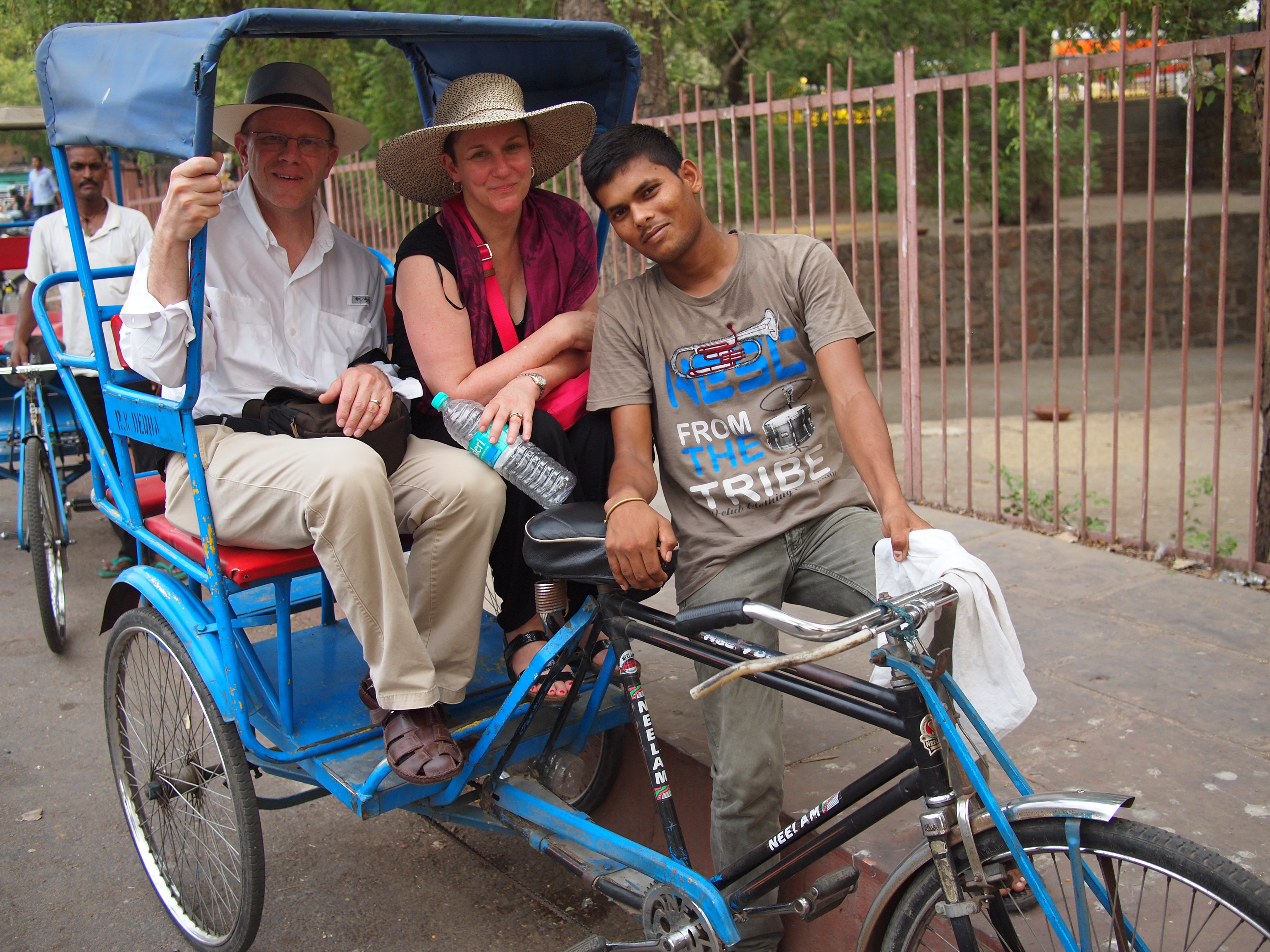 Tourists With The Rickshaw Driver