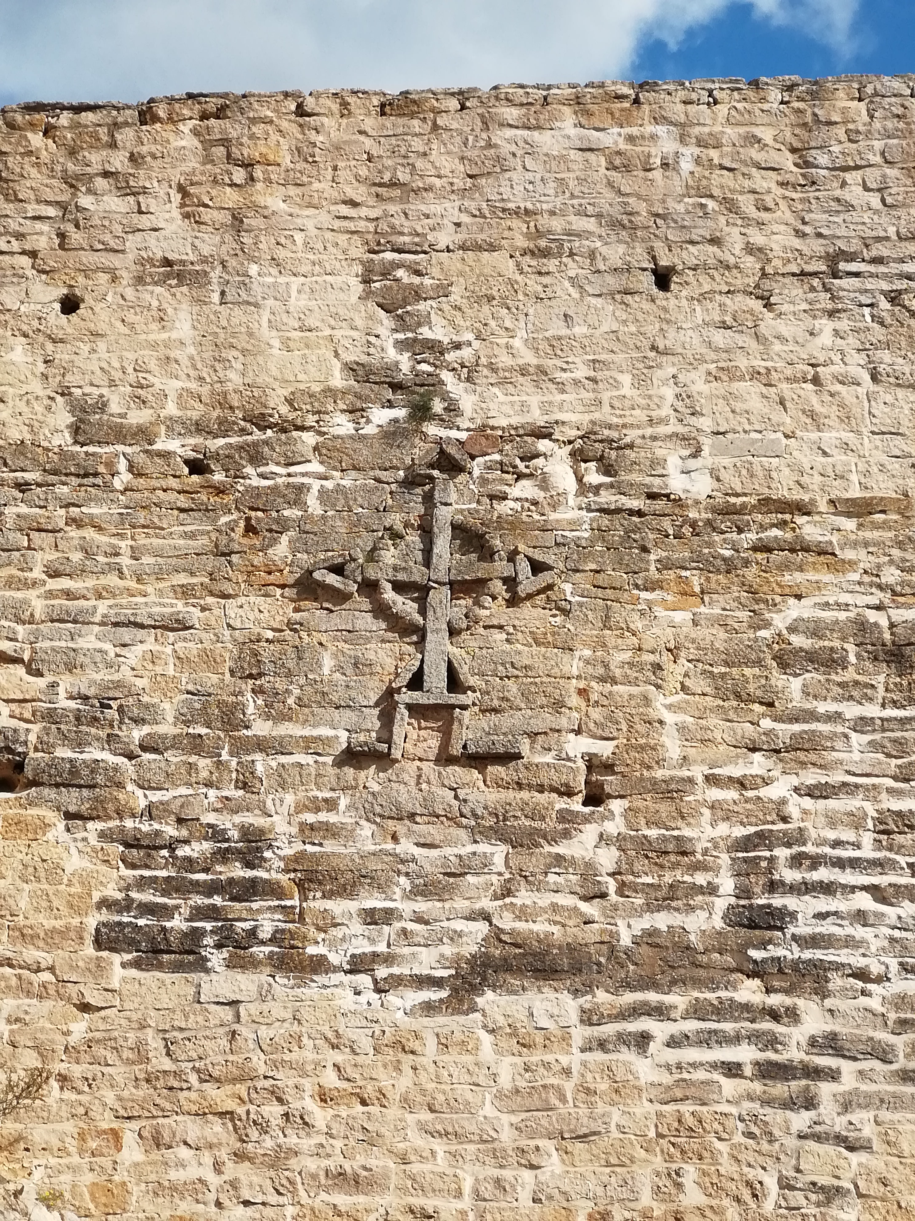 A cross decorating the wall of Izborsk 14th century fortress