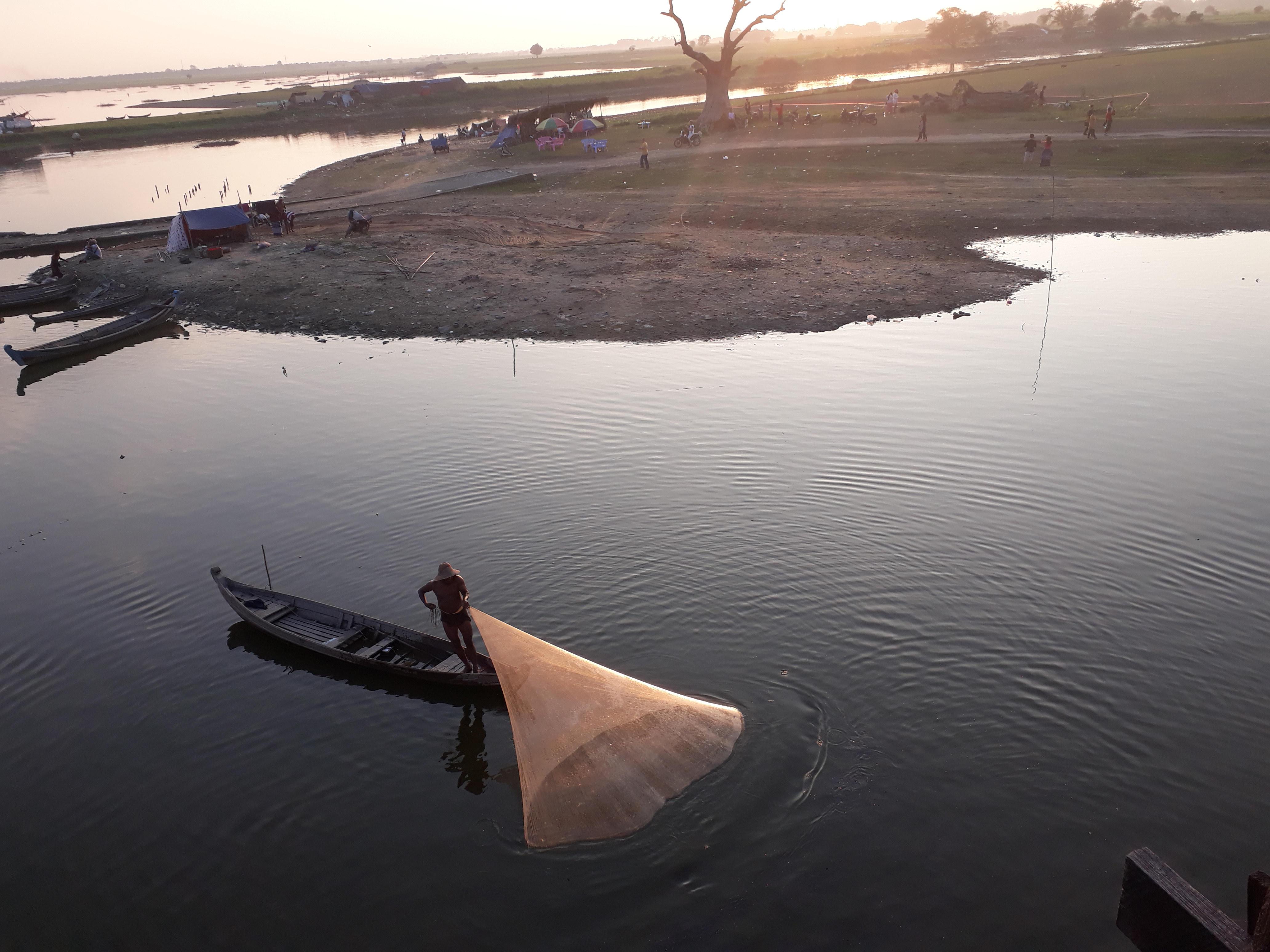 A fisherman at the longest teak wood bridge