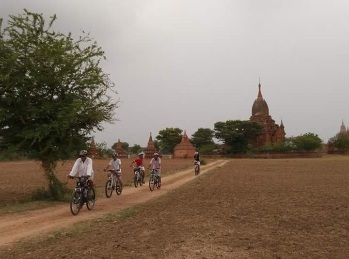 Tourists biking their way through village in Bagan