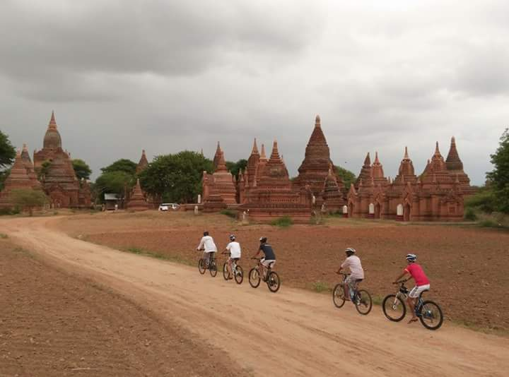 Pass by historic sites and temples while biking