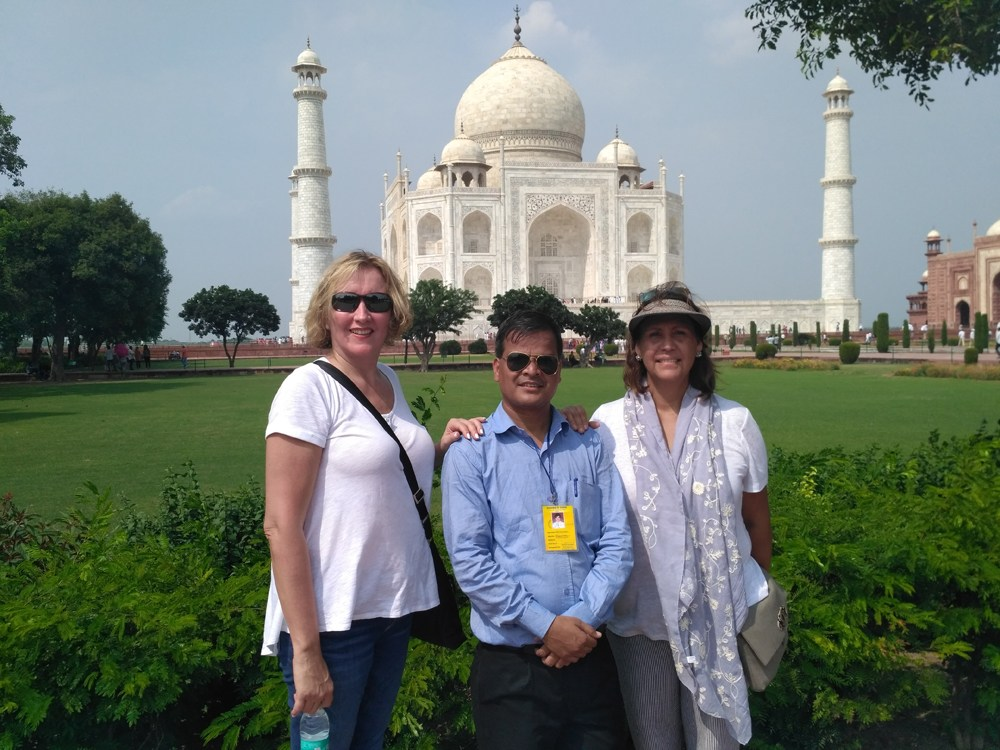 Tourists Posing Infront Of Taj Mahal
