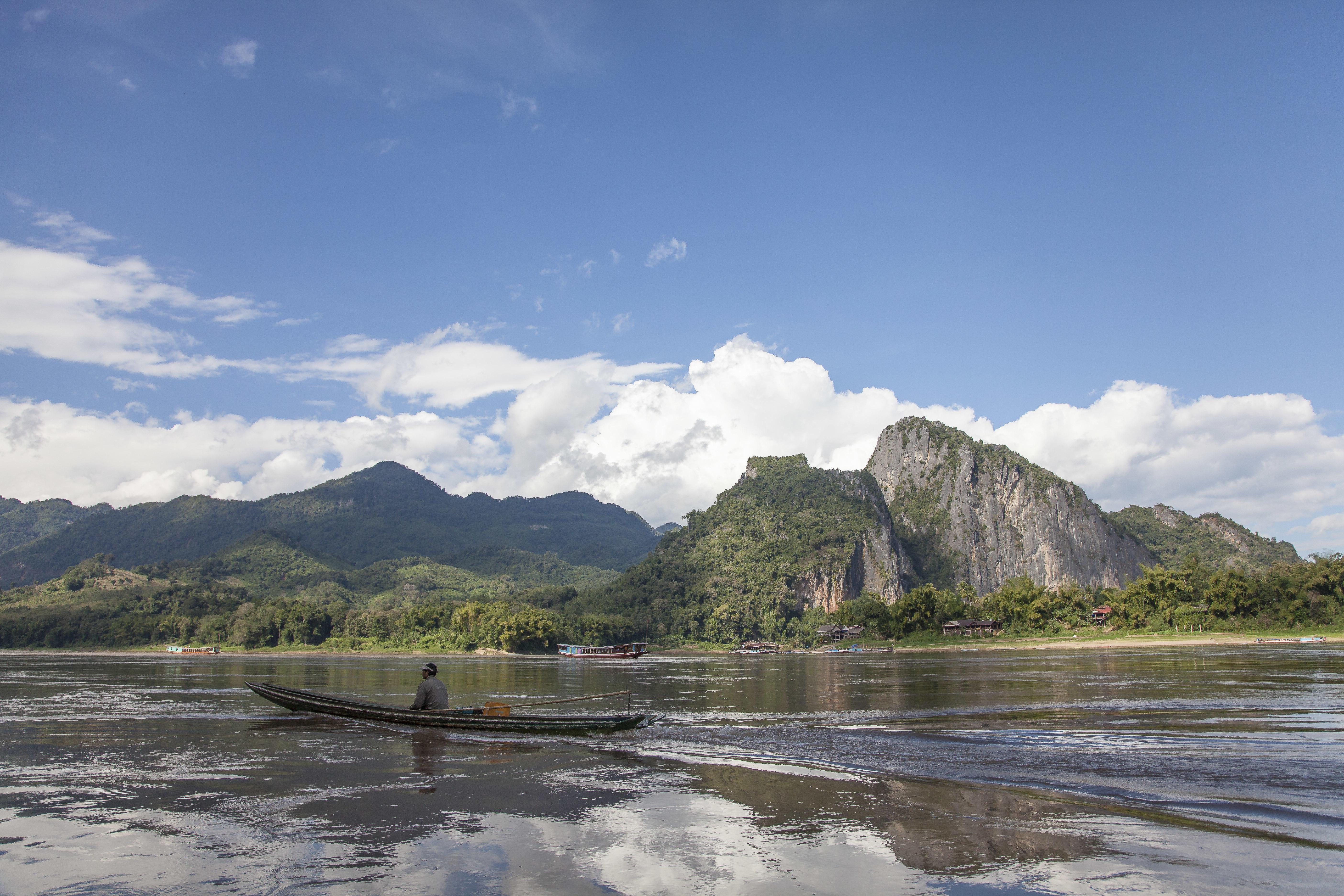 Take a boat ride at Mekong river