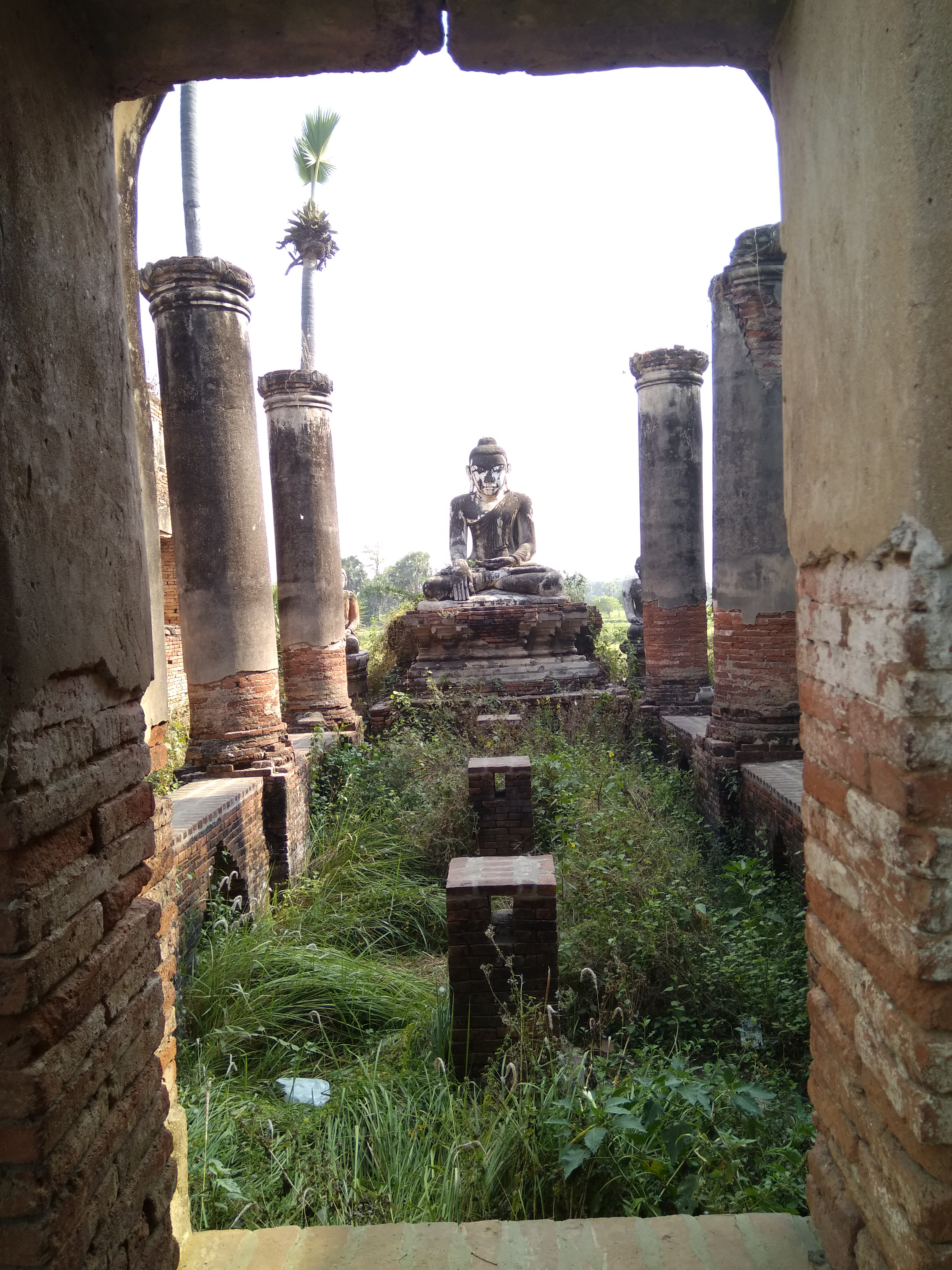 Temple Ruins And Buddha Statue In Ava