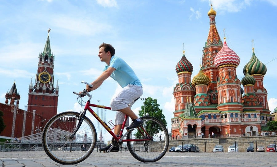 Cycling past St. Basil Cathedral n Moscow