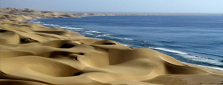 The sea reaching out to the sand dunes
