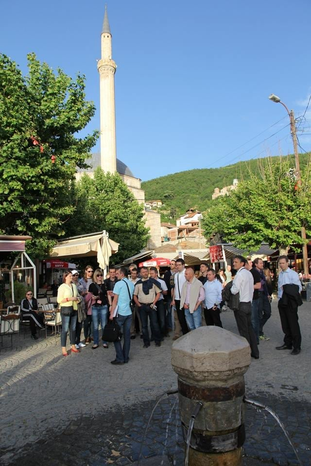 Tourists Interacting with the Guide before the Tour