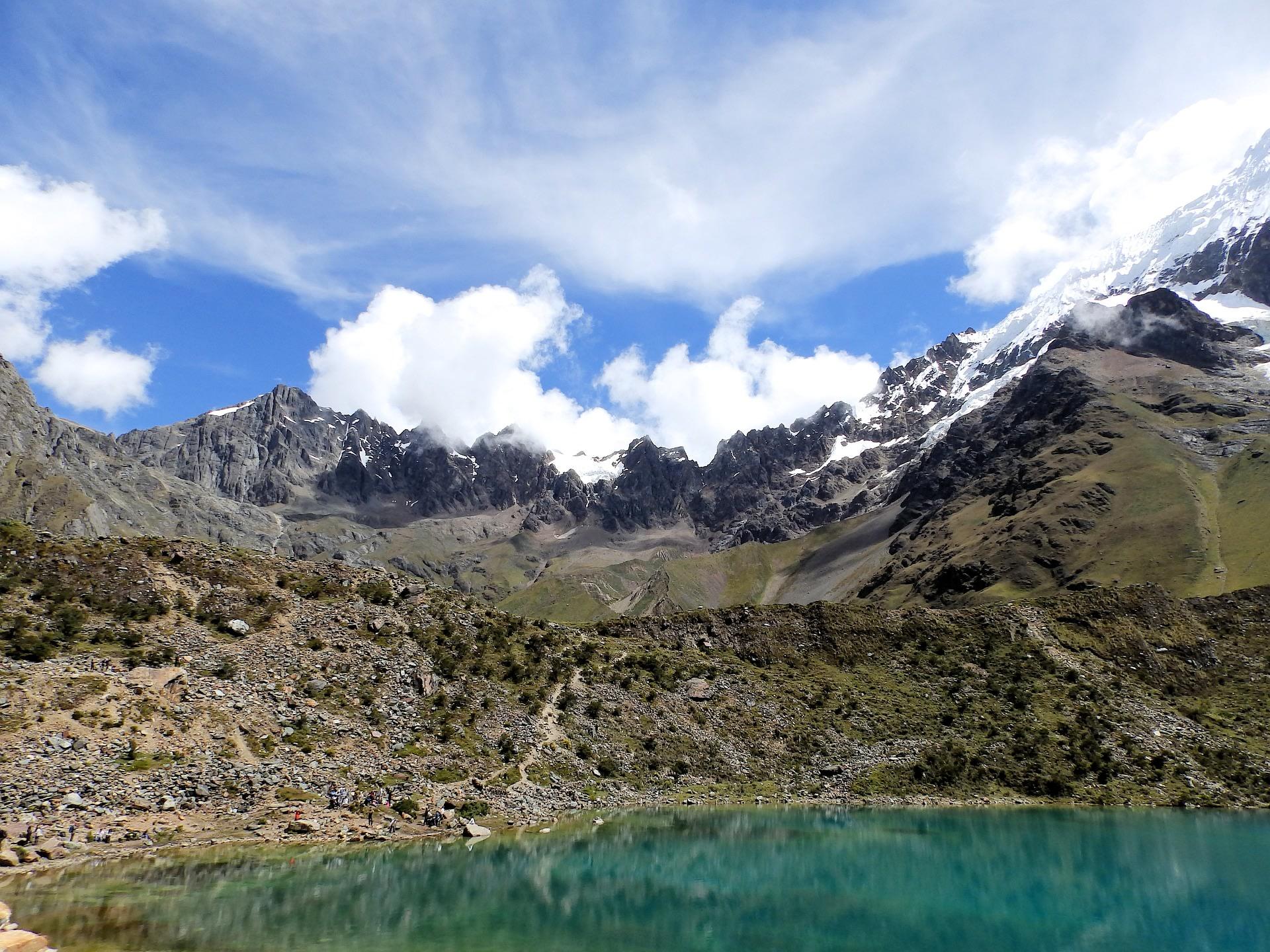 Visit Humantay, sits snugly between Humantay Mountain and Salkantay Mountain