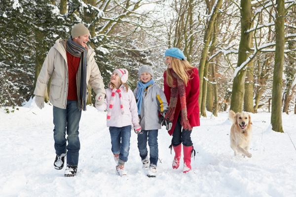 family-walking-dog-in-the-snow