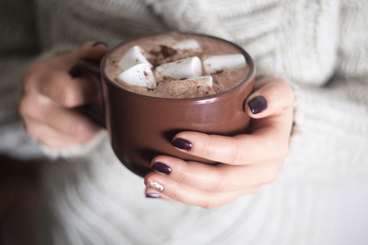 woman-holding-a-mug-of-hot-chocolate-with-marshmallows