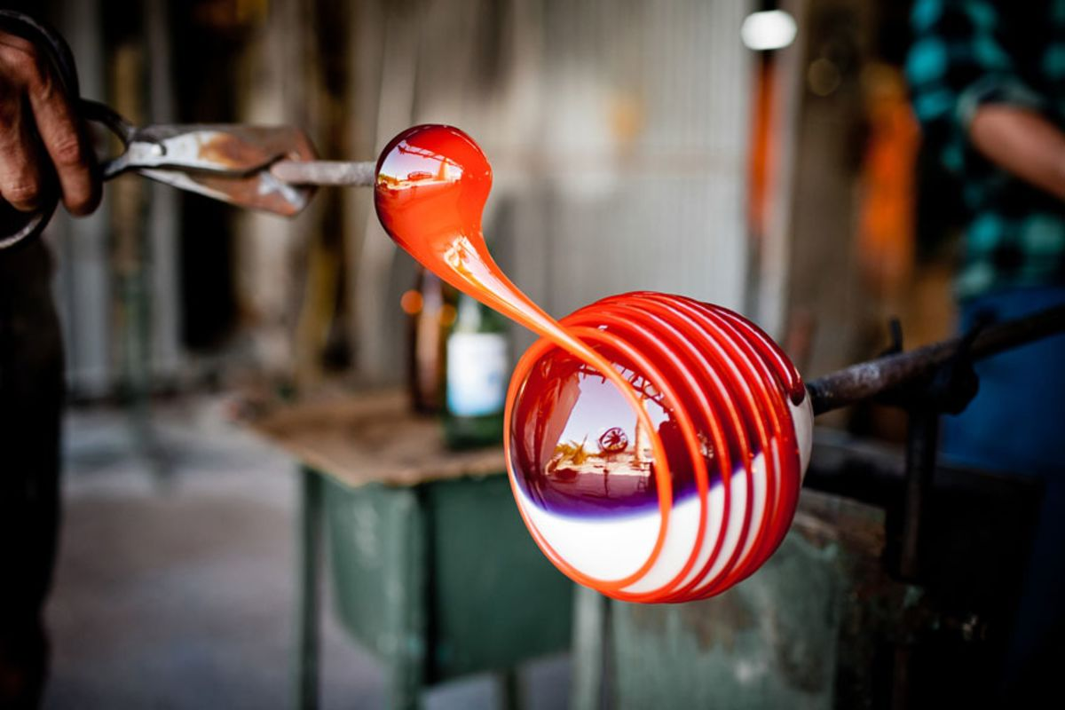 view-of-person-blowing-glass-in-workshop