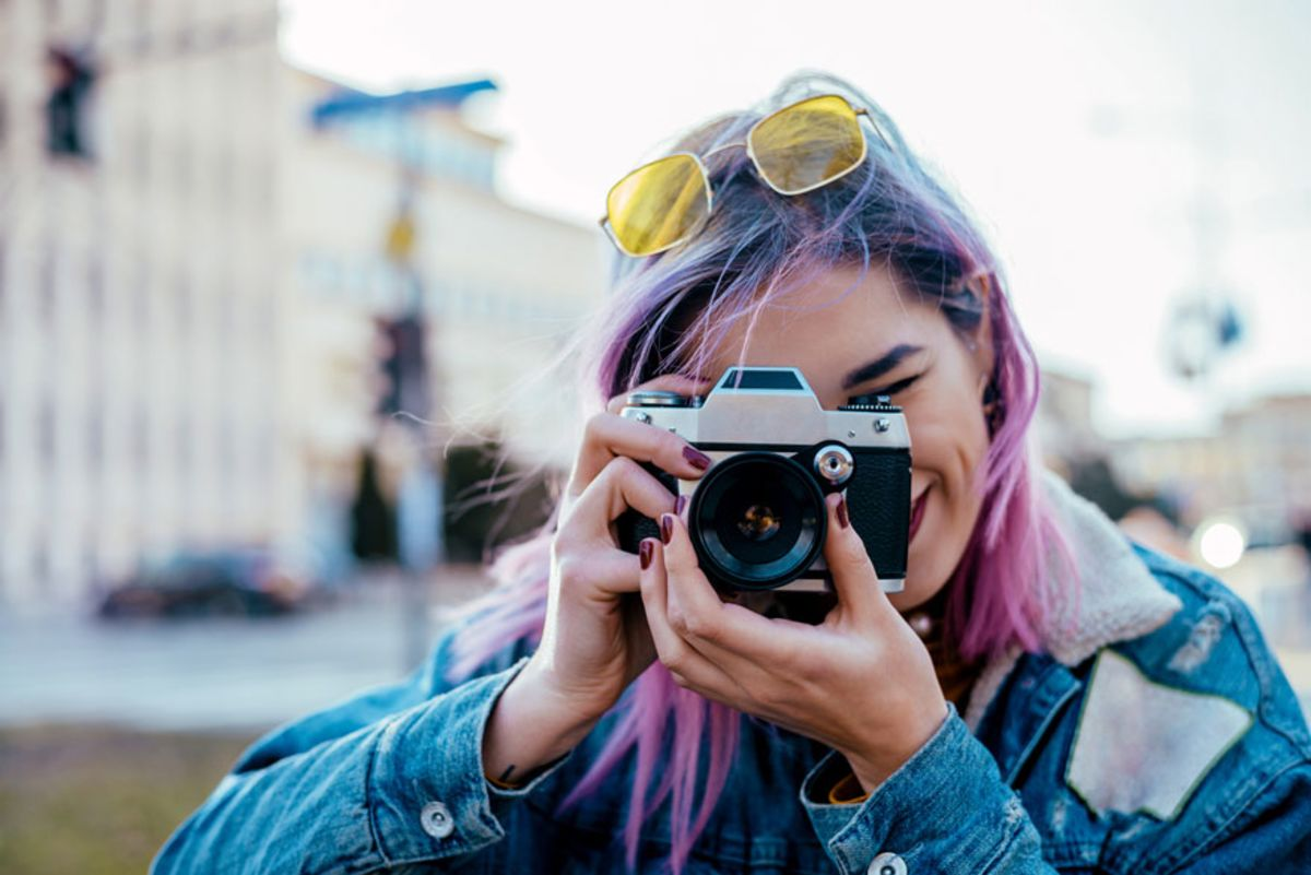woman-with-purple-hair-taking-photo