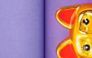 Purple double page spread of magazine