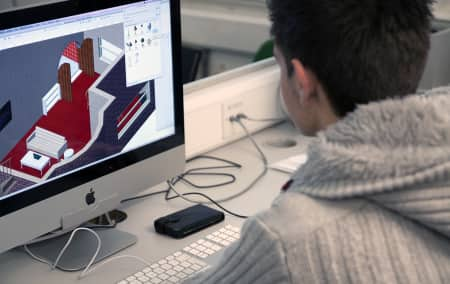 Student working at a Mac during an interactive design short course