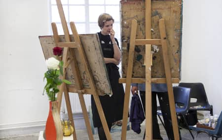 Student at an easel during Oil Painting Short Course.