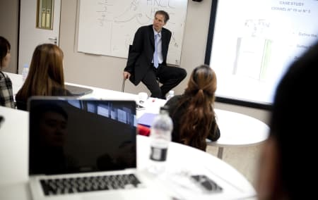 Image of tutor and students in Luxury brand management and product design short course
