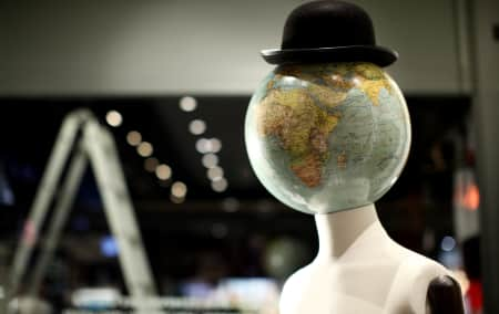 Mannequin with a globe for a head and a bowler hat.