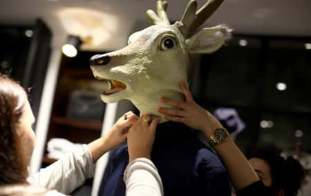 A deer head on a mannequin.