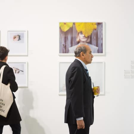Guests enjoy the exhibition of recent graduates' work, by Made in Arts London ©D Griffiths