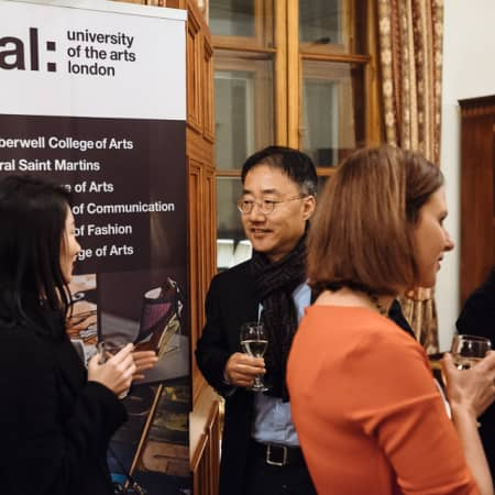 People talking at UAL alumni event in Seoul, Korea