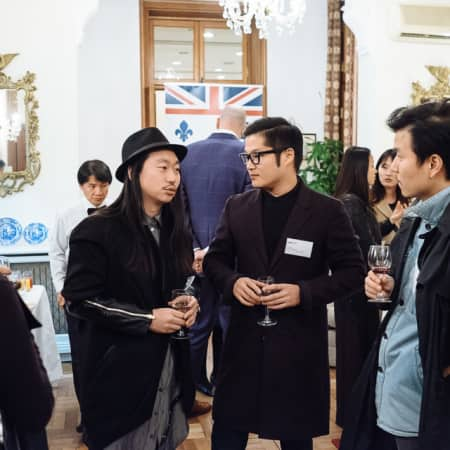 Three guests in conversation at UAL alumni event in Seoul, Korea