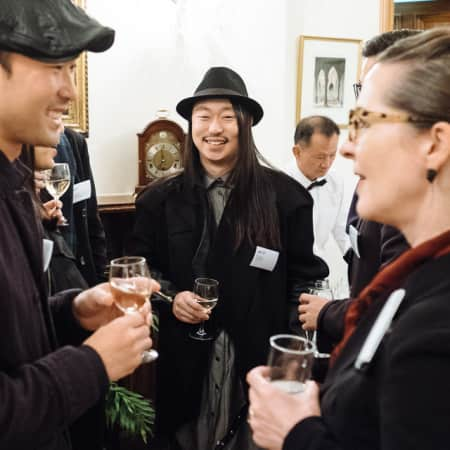 Image of two men and one woman at UAL alumni event