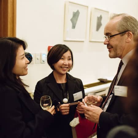 Image of people conversing at UAL alumni event in Seoul, Korea